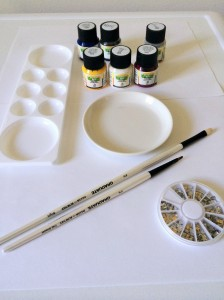 Ceramic paints, paint brushes, mixing tray, nail studs and a ceramic plate